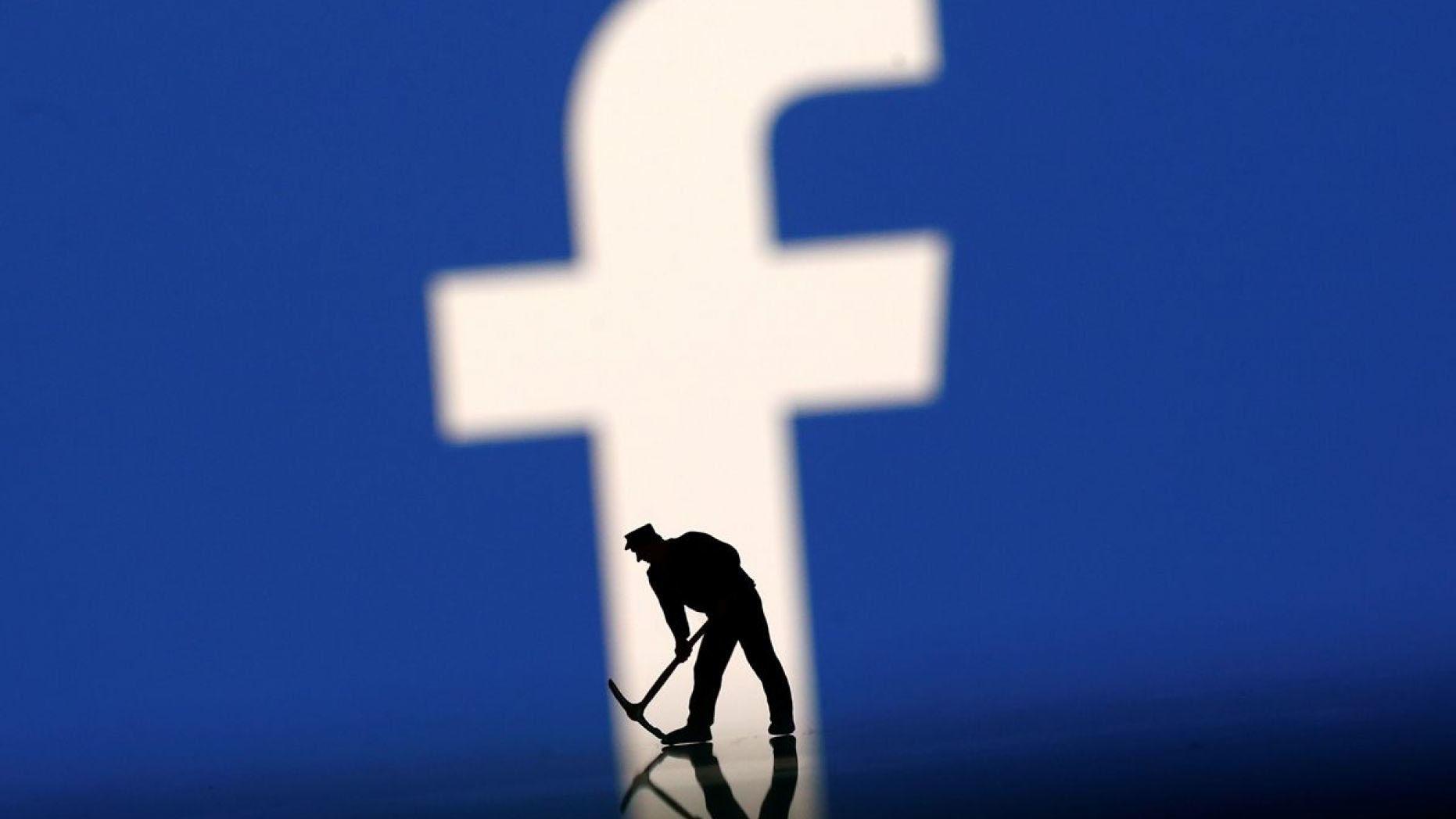 figurine in front of facebook logo